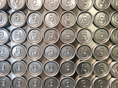 A shiny collection of beer cans are photographed from above and serve as a great background for food and drink concepts, or even recycling. Shot on an iPhone 6s Plus.
