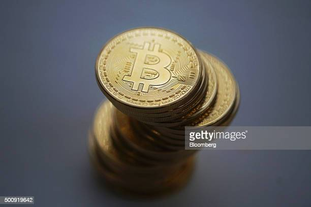 A collection of Bitcoins stand in this arranged photograph in Danbury UK on Thursday Dec 10 2015 Bitcoin the digital currency climbed on Wednesday to...