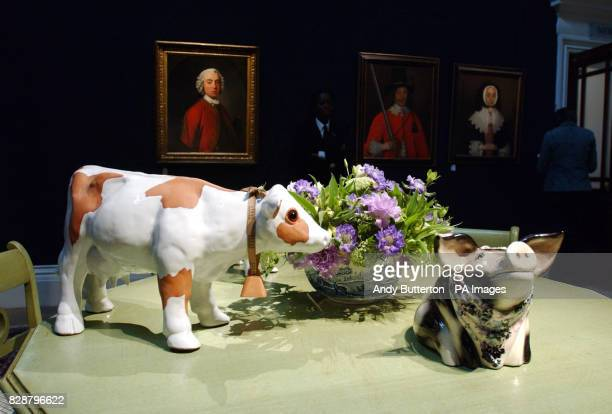 A collection of ceramic farm animals including a piggy bank one of the items on display at a press preview of an auction of the contents of Sir Elton...