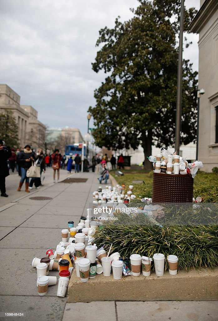 A collection of coffee cups lie piled up around a trash can on 17th street leading away from the National Mall where thousands of spectators watched the 57th United States Presidential Inauguration ceremony on January 21, 2013 in Washington, DC.