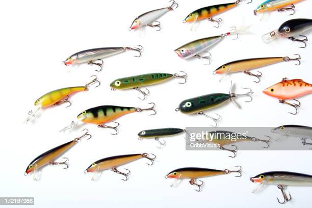 Collection of colorful fishing lures with hooks on white