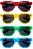 Collection of colorful sunglasses in a row on white background
