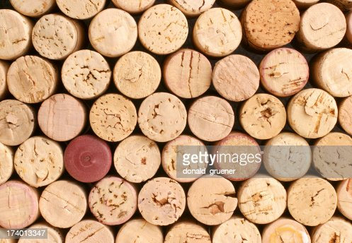 Collection of corks with one red one that doesn't match