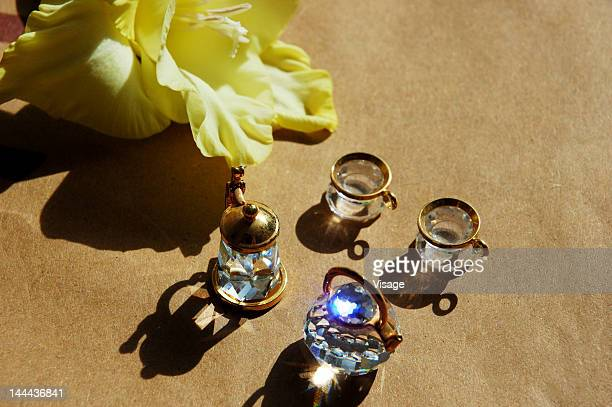 Collection of crystal decorative items and a flower