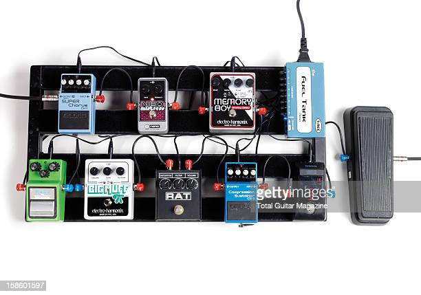 A collection of electric guitar effects pedals mounted to a pedal board photographed during a studio shoot for Total Guitar Magazine May 4 2012