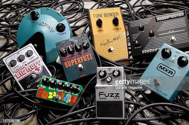 A collection of electric guitar fuzz effects pedals ElectroHarmonix Little Big Muff Pi Jim Dunlop JHF1 Jimi Hendrix Fuzz Face ZVex Fuzz Factory...
