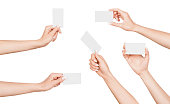 collection of female hand with business card on an isolated white background