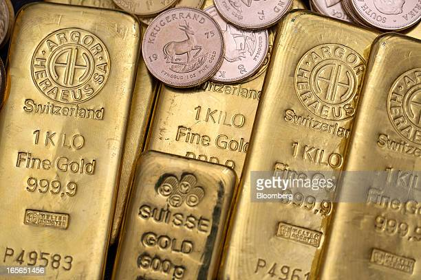 A collection of gold bars and South African gold Krugerrand coins are seen at London bullion dealers Gold Investments Ltd in this arranged photograph...
