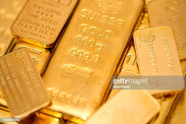 A collection of gold bars in various weights are seen at London bullion dealers Gold Investments Ltd in this arranged photograph in London UK on...