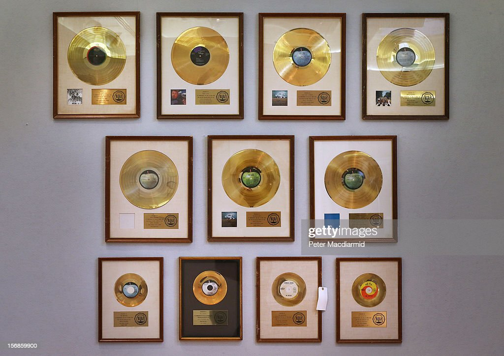 A collection of Gold Discs are displayed at Christie's on November 23, 2012 in London, England. The discs form part of Christie's Pop Culture sale on November 29 in London.