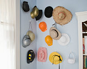 Collection of hats hanging on wall indoors
