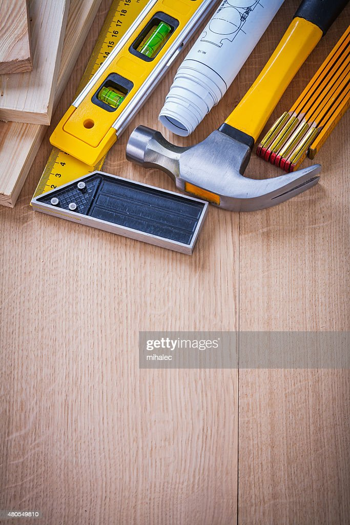 Collection of house-improvement working objects on wooden board : Stock Photo
