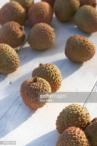 Collection of lychees on sunny table