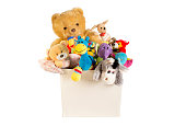 Collection of plush toys in white toys box isolated on white background