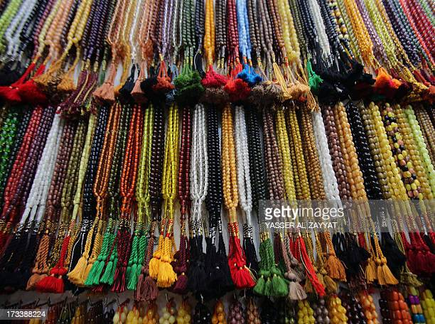 A collection of prayer beads are displayed at a shop in downtown Kuwait during the holy fasting month of Ramadan on July 13 2013 Throughout the month...