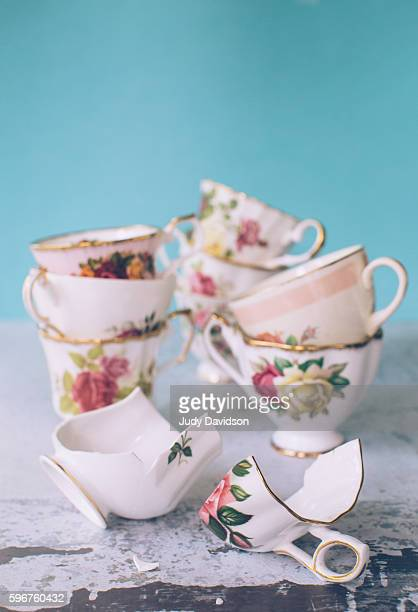 Collection of pretty floral teacups with one broken tea cup