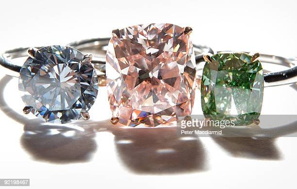 A collection of rare diamond rings is displayed at Sotheby's on October 22 2009 in London England Comprising of a cushion modified brilliantcut vivid...