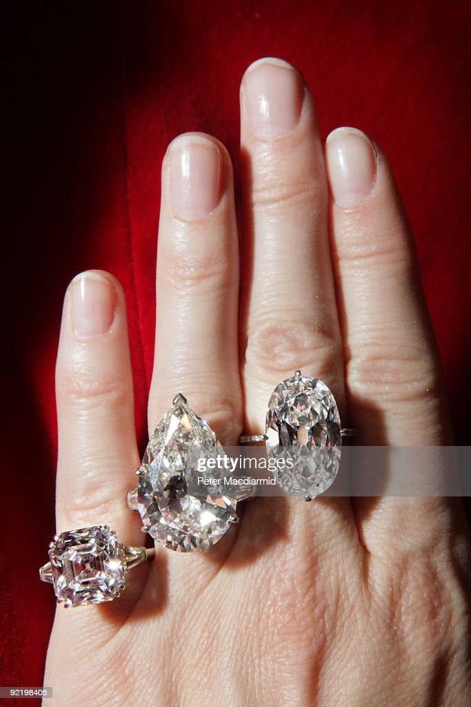 A collection of rare diamonds is displayed at Sotheby's on October 22, 2009 in London, England. Comprising of a pear-shaped diamond (C) the property of a Lady, the stone weighing 25.47 carats, H color, VS2 clarity mounted in platinum as a ring, flanked by baguette diamonds weighing approximately 2.00 carats estimated at USD $600,000 to 700,000, a diamond ring set with an oval brilliant-cut diamond (R) weighing 16.04 carats, F color, SI1 clarity, type IIa, within a platinum and diamond string mounting estimated at USD $350,000 to 450,000 and a square Emerald-Cut Diamond (L) of 9.69 carats set as a ring is both the highly desirable Asscher-cut and certified type IIa, the most transparent of diamonds. Offered from an Estate, this stone is E color, VVS2 clarity and may be potentially flawless estimated at USD $350,00 to 450,000. This collection will be sold in the Magnificent Jewels Sale at Sotheby's New York on December 9.