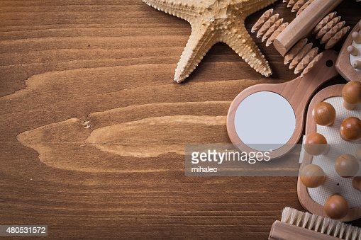 Collection of sauna accessories on brown pine vintage board heal : Stock Photo