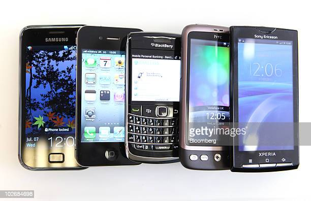 A collection of smartphones from left a Samsung Galaxy S an Apple Inc iPhone 4 a Blackberry 9700 an HTC Desire and a Sony Ericsson Xperia X10 are...