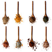 Collection of Various Spices in Wooden Spoons