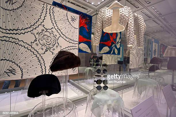 A collection of sunglasses worn by Princess Margaret is displayed next to a Bolero jacket and a few hats at the Fashion Rules Exhibition at...