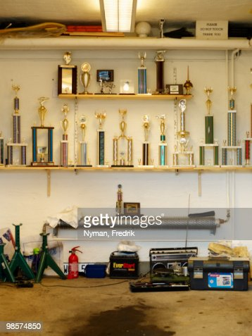 A collection of trophies in a garage.
