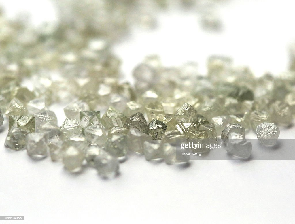 A collection of uncut colorless diamonds are seen on a sorting table at the De Beers office in London, U.K., on Friday, Nov. 16, 2012. De Beers, the biggest diamond producer by revenue, is moving the sorting and trading of rough stones to Botswana from London to secure access to the world's largest supplier of diamonds by value and challenge Antwerp's dominance as the world's biggest trading hub for rough diamonds. Photographer: Chris Ratcliffe/Bloomberg via Getty Images