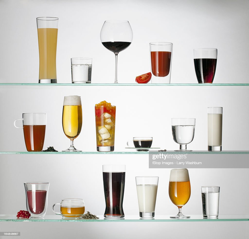 A Collection Of Various Types Of Drinking Glasses Filled ...
