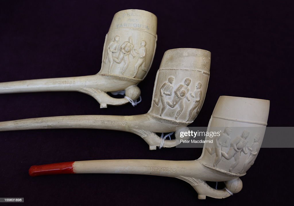 A collection of Victorian smokers pipes decorated with sporting releifs are shown at Sotheby's on November 6, 2012 in London, England. Graham Budd auctioneers are holding a two day sale of Sporting Memorabilia at Sotheby's in London on 5-6th November 2012.
