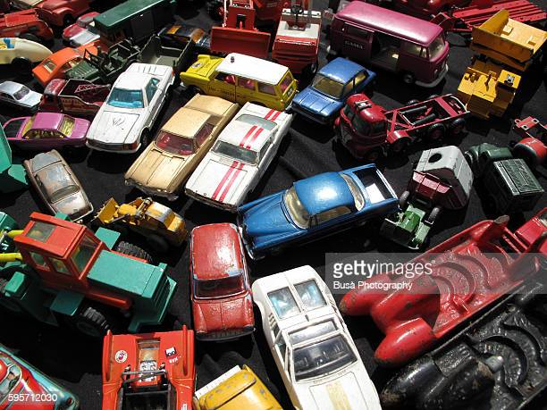 A collection of vintage model cars in a flea market
