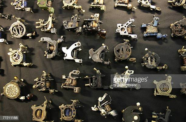 A collection of vintage needle guns are displayed during a threeday tattoo convention that is held in East London 05 October 2007 where over 150...