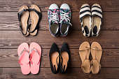 Collection of women's shoes on wooden background. Top view