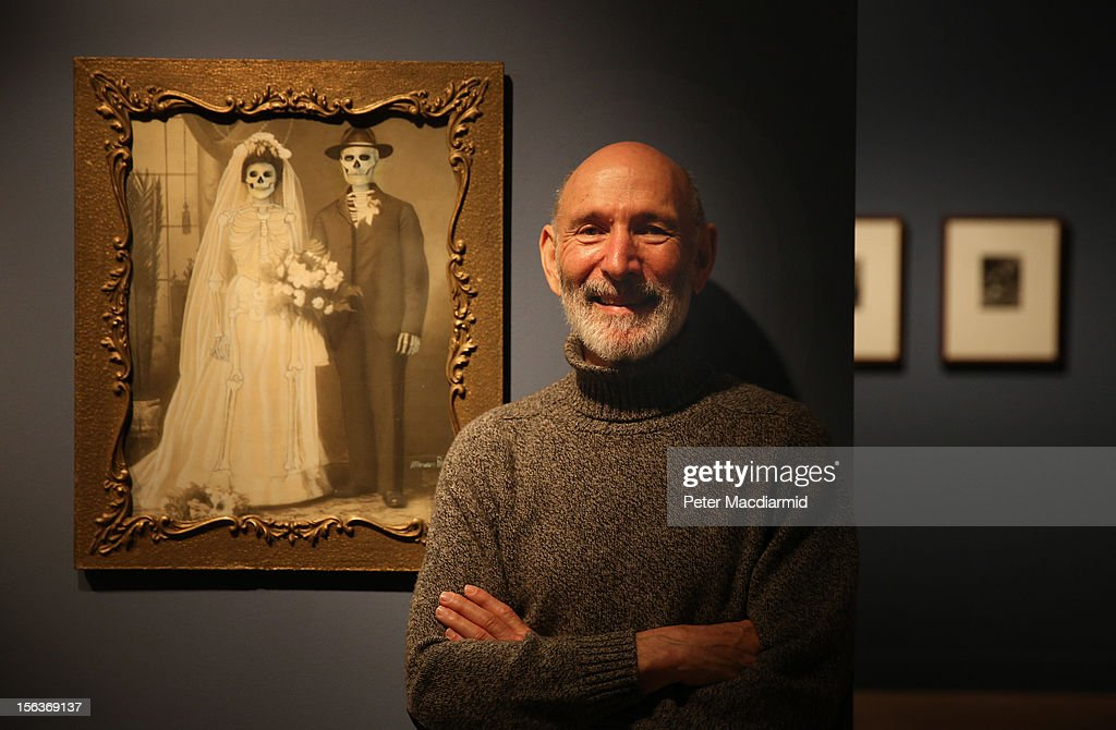 Collection owner Richard Harris stands in front of a work my Mexican artist Marcos Raya called Family Portrait : Wedding at the 'Death: A Self-portrait' exhibition at the Wellcome Collection on November 14, 2012 in London, England. The exhibition showcases 300 works from a unique collection by Richard Harris, a former antique print dealer from Chicago, devoted to the iconography of death. The display highlights art works, historical artifacts, anatomical illustrations and ephemera from around the world and opens on November 15, 2012 until February 24, 2013.