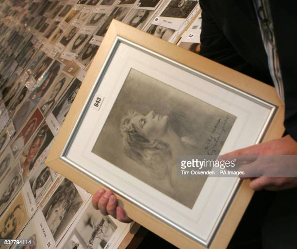 Collector Alan Robinson holds his autographed photograph of 1954 Oscar winner Greta Garbo
