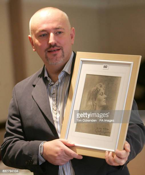 Collector Alan Robinson with his autographed photograph of 1954 Oscar winner Greta Garbo