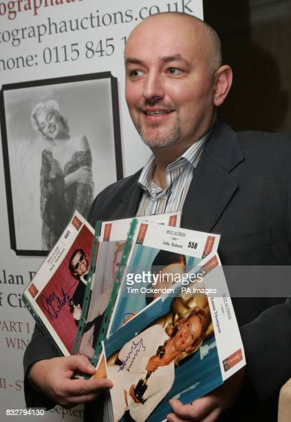 Collector Alan Robinson with some of his autographed photographs of Oscar winners