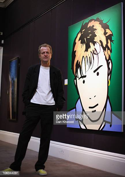 Collector Robert Devereux stands beside a piece of work by British artist Julian Opie depicting an image of Blur frontman Damon Alburn at Sotheby's...