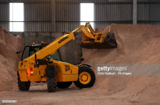 A JCB collects a scoop of salt grit at Wittlesford Depot in Cambridgeshire as the counties gritters standby during the cold snap