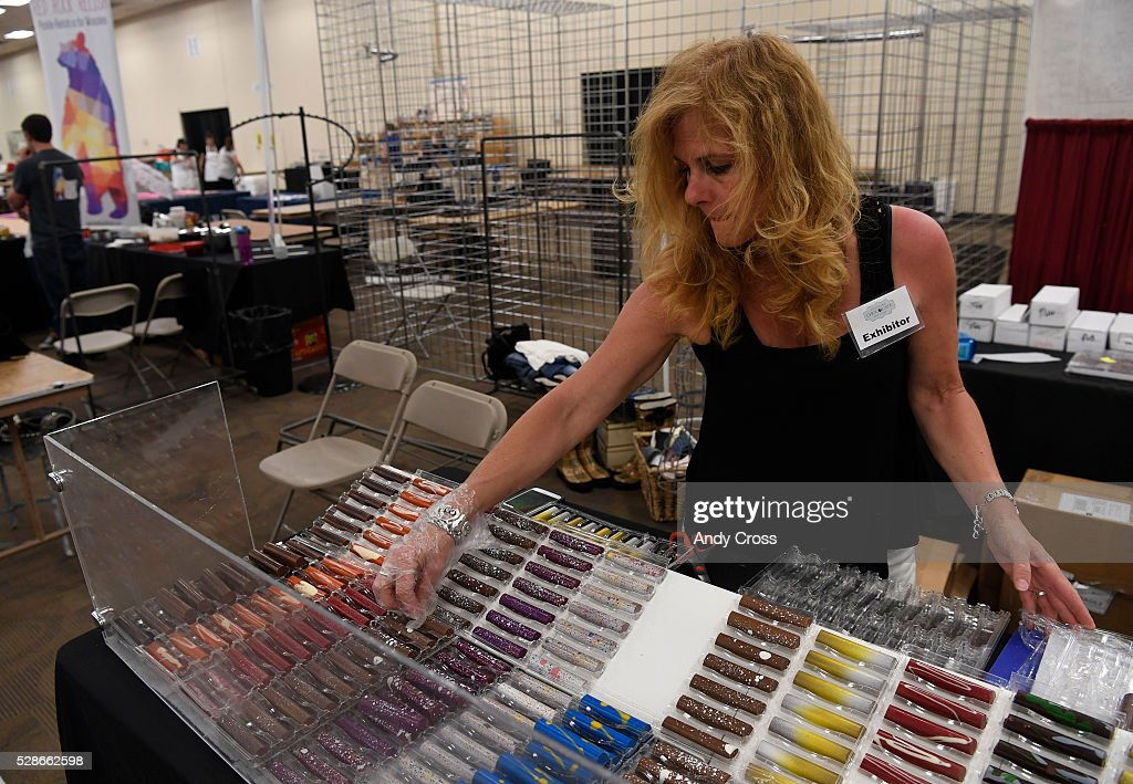 Colleen McGlynn, owner of the Chocolate Moonshine Co. out of Colorado Springs, Colorado, displays artisan fudge bars at the Colorado Chocolate Festival at the Denver Mart May 06, 2016.
