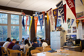 College banners hang in the classroom of teacher Chrys Latham as she leads a senior advisory period at Washington Latin Public Charter School in...