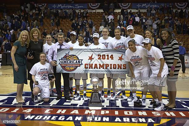 American Athletic Conference Tournament UConn Breanna Stewart and teammates victorious posing for team photo with banner and trophy after winning...