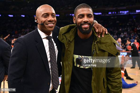 ESPN college basketball analyst Jay Williams and Kyrie Irving of the Cleveland Cavaliers pose for a photo during the Jimmy V Classic at Madison...