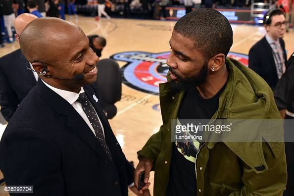 ESPN college basketball analyst Jay Williams talks with Kyrie Irving of the Cleveland Cavaliers during the Jimmy V Classic at Madison Square Garden...