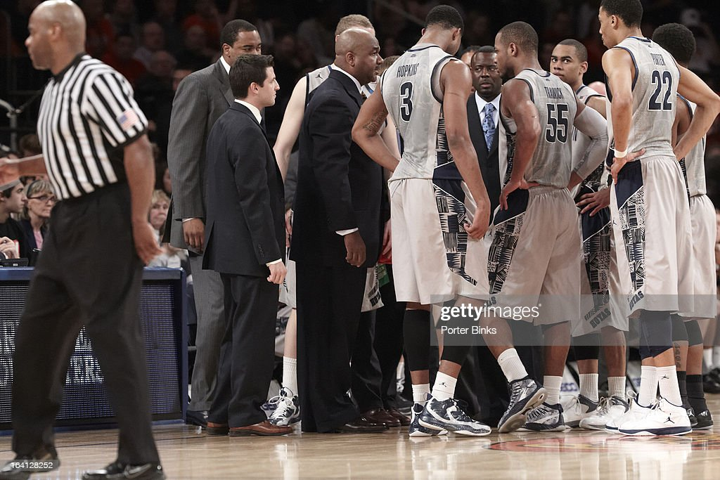 Georgetown coach John Thompson III in huddle with players during timeout during Semifinal game vs Syracuse at Madison Square Garden. Porter Binks F43 )