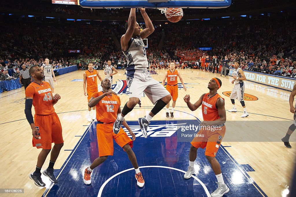 Georgetown Mikael Hopkins (3) in action, dunking vs Syracuse during Semifinal game at Madison Square Garden. Porter Binks F8 )