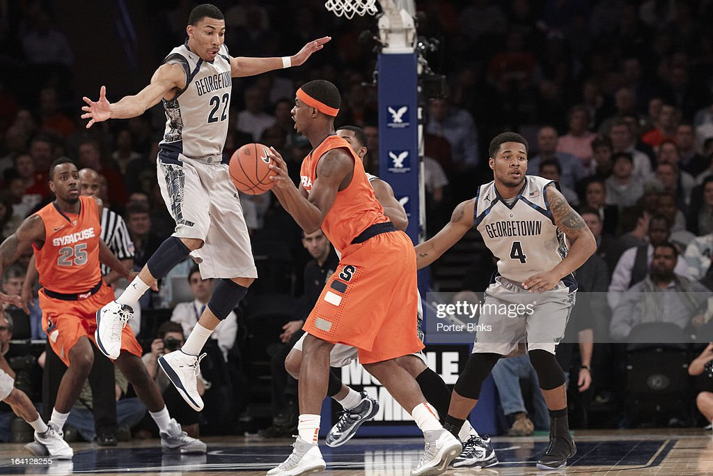 Georgetown Otto Porter Jr. (22) in action, defense vs Syracuse C.J. Fair (5) during Semifinal game at Madison Square Garden. Porter Binks F56 )