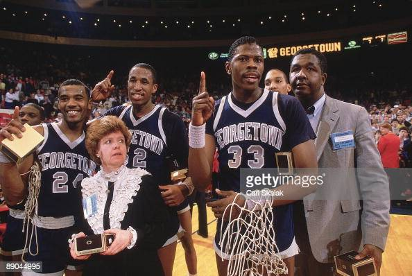 Big East Tournament Georgetown Patrick Ewing victorious with head coach John Thompson after winning championship game vs St John's New York NY...