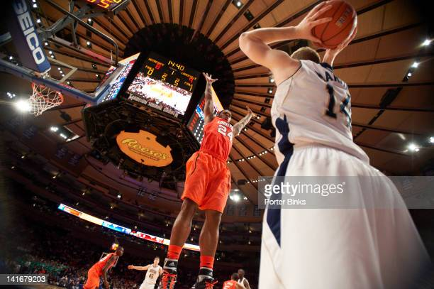Big East Tournament Louisville Chane Behanan in action defense vs Notre Dame Scott Martin during Semifinals game at Madison Square Garden New York NY...