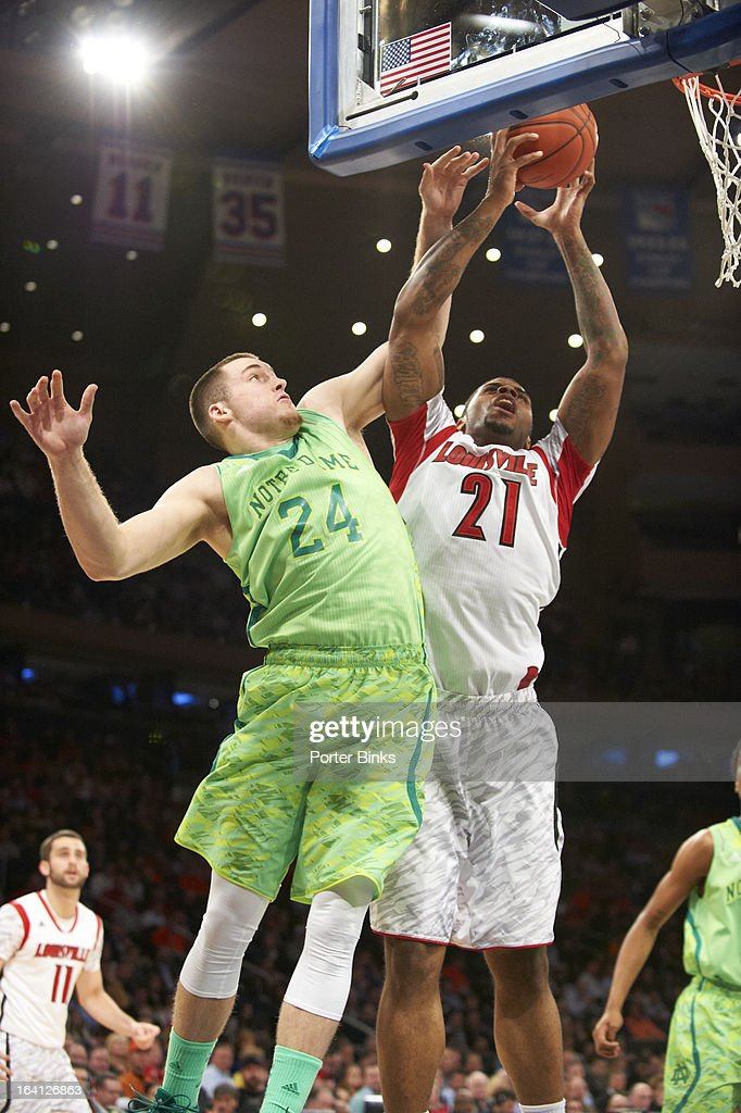Louisville Chane Behanan (21) in action vs Notre Dame Pat Connaughton (24) during Semifinal game at Madison Square Garden. Porter Binks F11 )